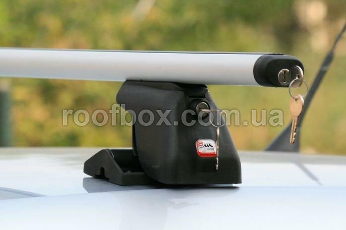 Фото - Автобагажник на крышу Amos алюминиевый с аэродинамическим профилем под заводские посадочные места.