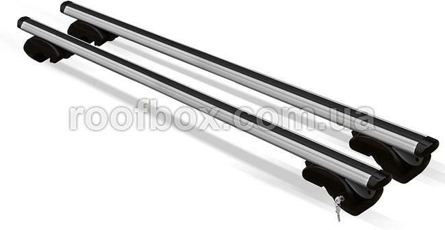 Фото - Автобагажник на крышу Menabo алюминиевый с аэродинамическим профилем под рейлинг